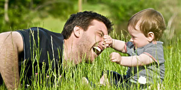 child grabbing his fathers nose
